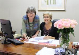 Mrs Liz Crosly signing her last Departmental payslip.